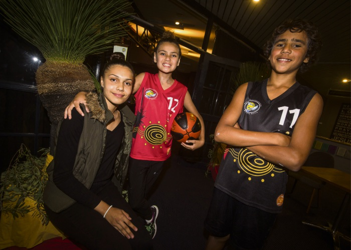 Moorditj Keila young gun and uniform designer Angel Smith with basketballers Alice Inman and Stanley Webb modelling the club's new outfits. Picture: Matt Jelonek