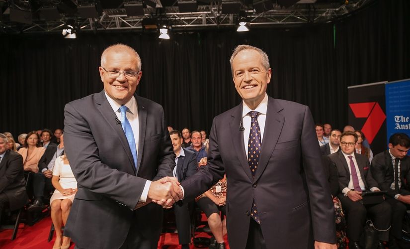 Australian Prime Minister Scott Morrison and Opposition Leader Bill Shorten shake hands before the first leaders forum at the Seven West Media Studios in Perth yesterday. Photo: AAP