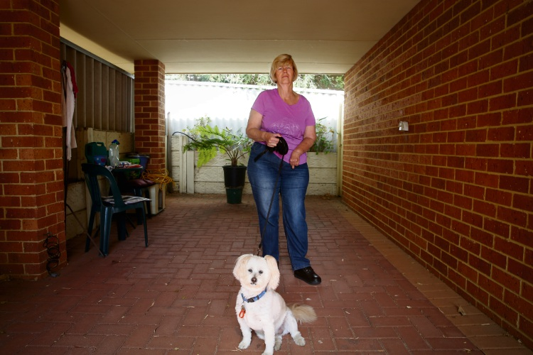 Ingrid Vlietman's electric tricycle was stolen from her carport on April 24. It was the only form orf transport for Ingrid, who has cerebral palsy, and her dog Charlie Picture: Andrew Ritchie www.communitypix.com.au   d492784