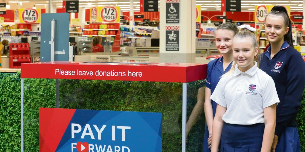 St Stephen's School Carramar students Ella, Lucy and Olivia Rivers with the donation box at Banksia Grove Village.
