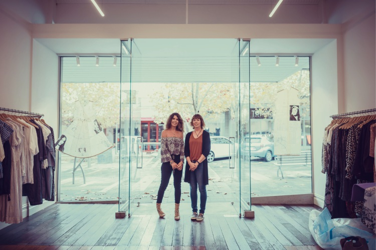 Heloise Roberts and Kirsten Makinson with their installation in Ricarda's windows.