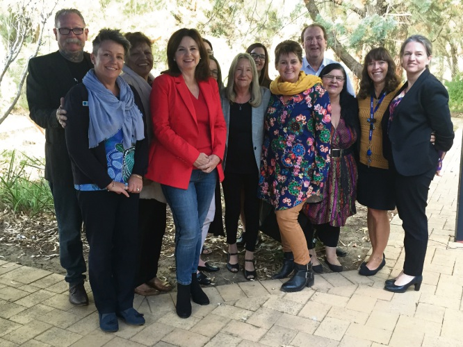 Canning Labor candidate Mellisa Teede (fourth left), Lynn Rogers (centre) and Senator Louise Pratt (far right) with WestAus staff and board members.