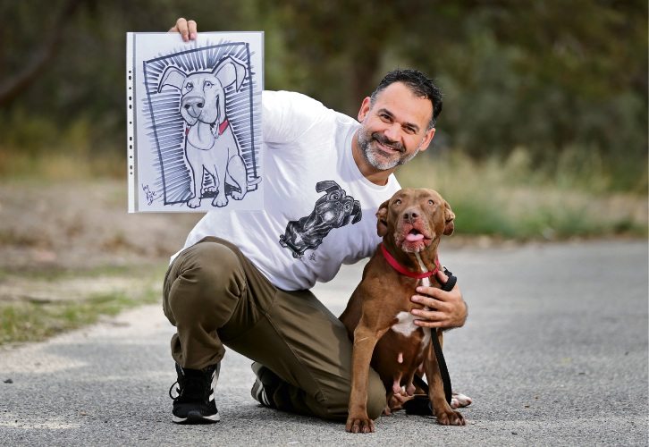Caricature artist and Rick Adams, of Ridgewood, pictured with Lady (5) and her caricature drawing at RSPCA WA in Malaga. Picture: David Baylis www.communitypix.com.au d492753