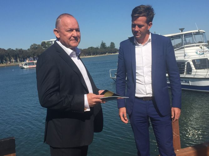 Deputy Commissioner (Special Services) WA Police and advisory board chairman Stephen Brown discusses the report with Mayor Rhys Williams.