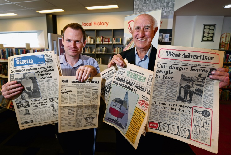 City of South Perth's local history librarian Anthony Styan and Bill Gleeson with some of the old newspapers. Picture: David Baylis.