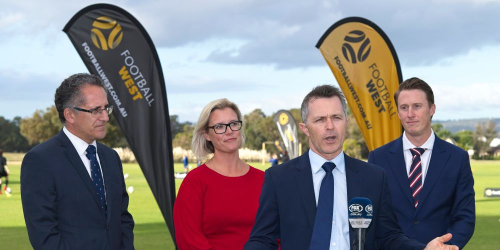 Shadow Minister for Trade and Investment Jason Clare announces Labor's $20 million election commitment, watched by Football West Chairman Sherif Andrawes, left, Labor candidate Hannah Beazley and Football West CEO James Curtis.
