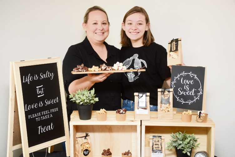 Tarryn Fitzpatrick with daughter Taylah at Bee Popped. Picture: Jon Hewson