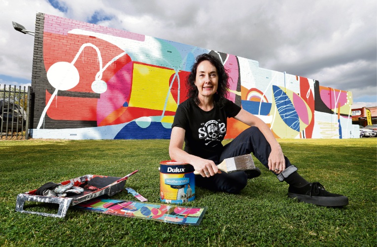 Sioux Tempestt has painted her abstract mural 'Interchange' in East Victoria Park with her partner in three days. Picture: David Baylis.
