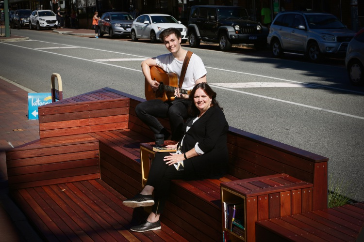 Musician Mitchell Martin with City of Perth deputy chair commissioner Gaye McMath at the parklet on Hampden Rd Nedlands. There will be regular live music at the parklets. Picture: Andrew Ritchie www.communitypix.com.au   d492861