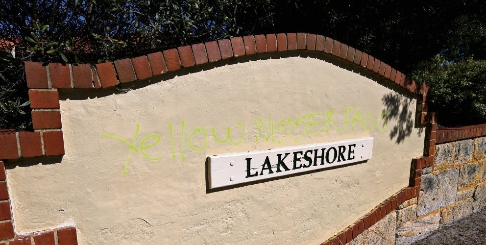 Racist remarks have now been removed from the Lakeshore Estate sign. Picture: David Baylis