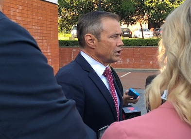 Health Minister Roger Cook talks to the media.