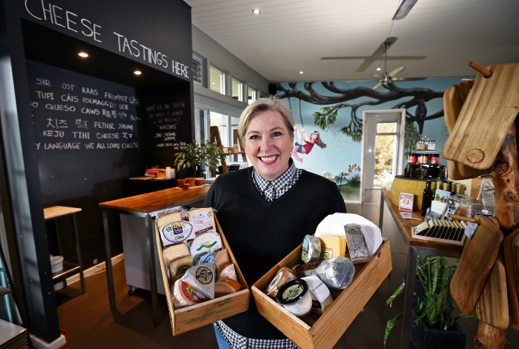 Sarah Howlett (Manager, The Cheese Barrel) with a selection of cheese.
