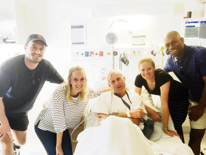 Mark Vivian in hospital with teachers Boston Williamson, Renea Mayer, Sarah Fogliani and Marius Ndiaye.