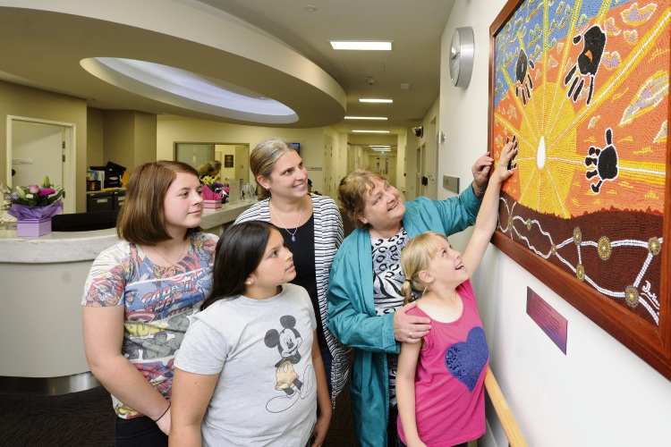 Artist Julie-Anne Darling, surrounded by her daughters and granddaughters, gifted a painting to Joondalup Private Hospital's maternity ward. Pictures: Chris Kershaw