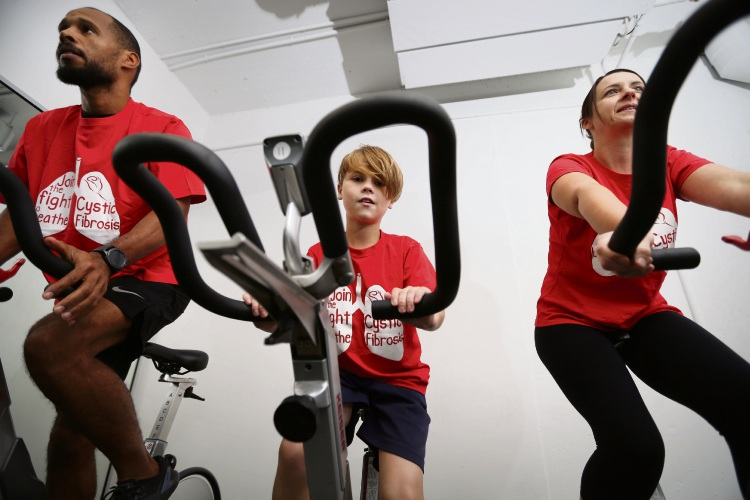 Clayton McGee (Staff manager Vault), Dylan Cooper (10) and mum Karen Cooper. Floreat boy Dylan Cystic Fibrosis his mum Karen is organising a 65 roses spin cycle challenge this yearfor Cystic Fibrosis month (May) at Vault Fitness Centre Picture: Andrew Ritchie www.communitypix.com.au   d493162a