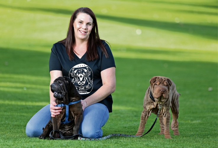 Shar pei rescue volunteer Natasha Goodchild with one-year-old Clyde and her two-year-old shar pei Marvin. Picture: David Baylis d493138
