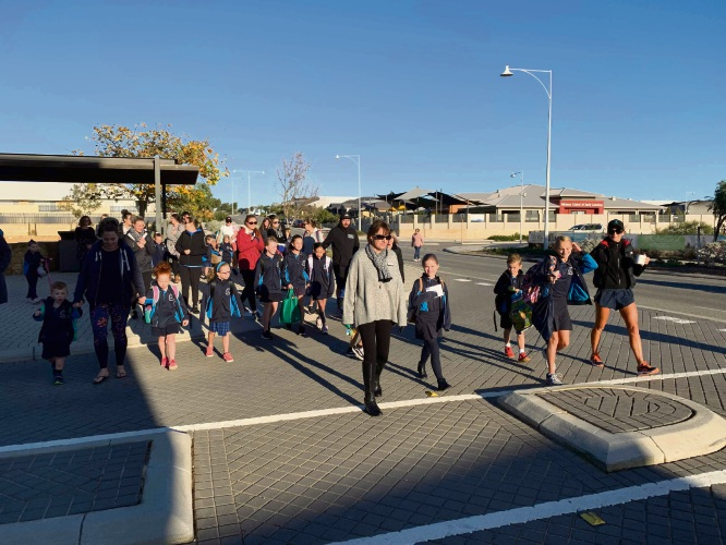 Alkimos Primary teachers, students and parents walk to school.