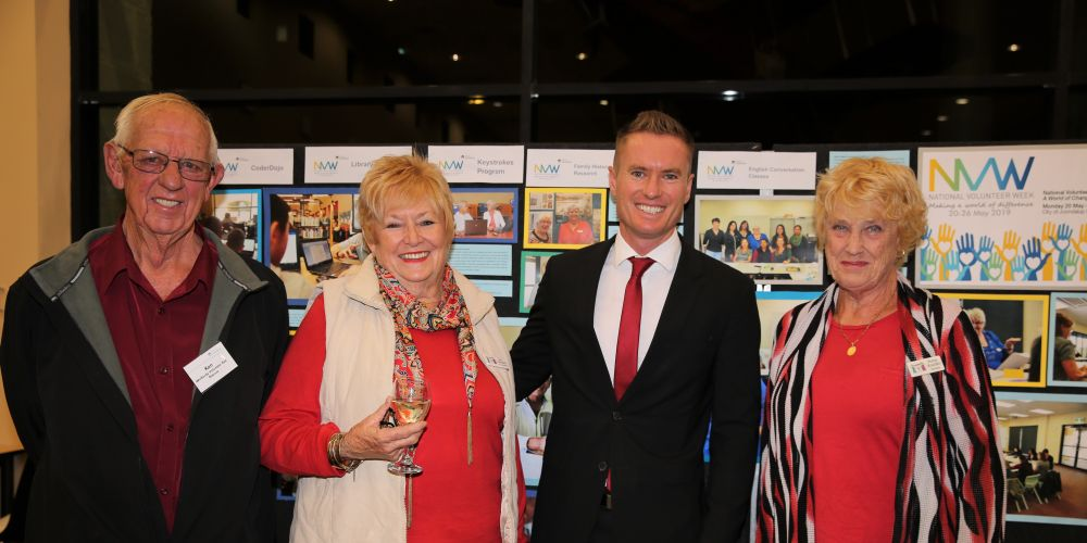 2018 Volunteer of the Year Ken Blackie, Jan Standon, Joondalup Mayor Albert Jacob and Penny Rowden at the launch of A World of Change: An Exhibition of Volunteer Stories, all wearing red – the colour associated with volunteering.