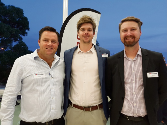 Martyn Ferris with Fremantle Dockers Matt Diedrich and Travis Kalin.