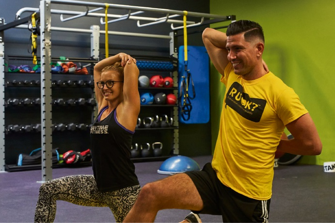 Anytime Fitness trainer Chris Nelson and franchise owner Amy Doughty.