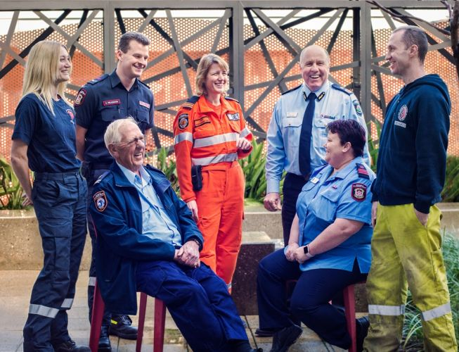 Fire and Emergency Services Commissioner Darren Klemm (standing, second from right) with volunteers Samantha Unstead, Simon Wilkinson, Hazel Darkin and David Patterson and (seated) Ken Blackie and Nicole (Nikki) Woods.