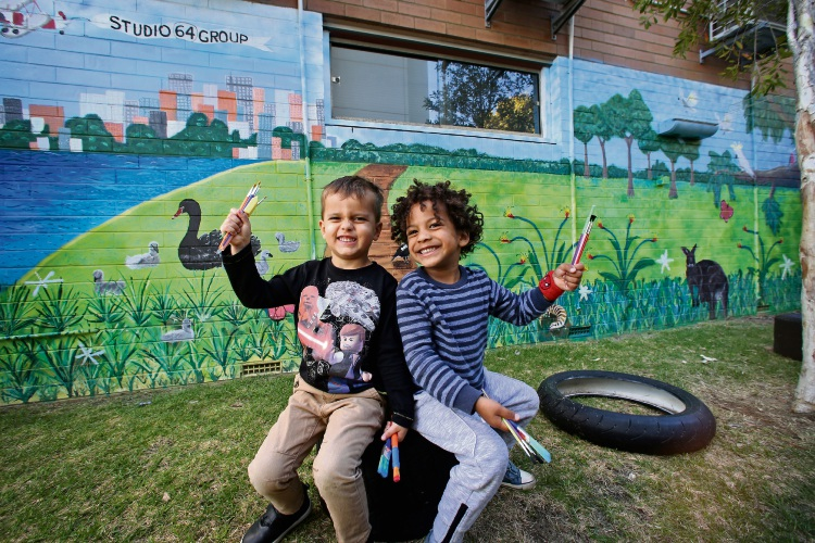 ed Duscher (4) and Tayo Madehin (3) in front of the new mural at the Studio 64 Early Learning and Kindergarten in South Perth. Picture: David Baylis www.communitypix.com.au d493057
