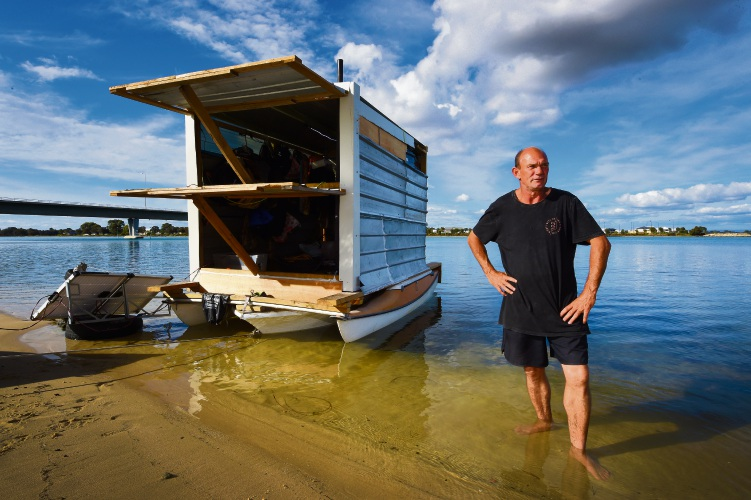 Phil Wren with his homemade houseboat.