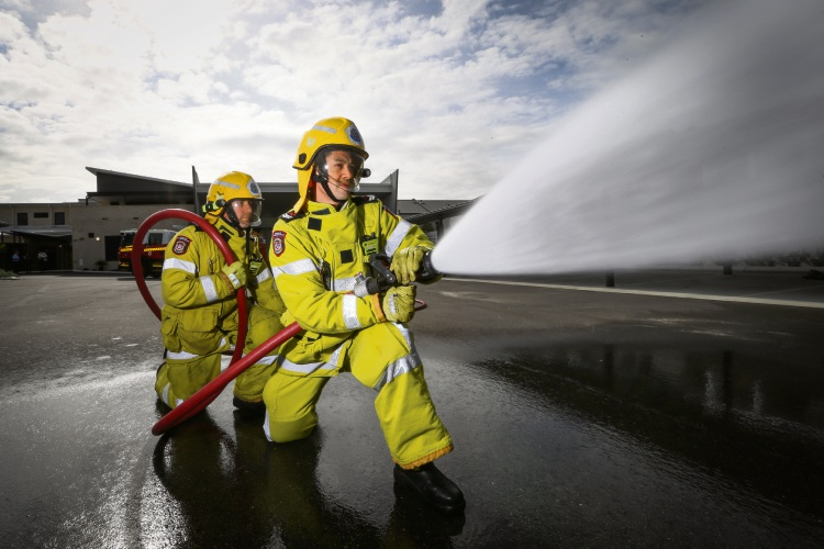 Lee Draman and Dave Uphill practising some drills at the fire station in West Perth Pic: Andrew Ritchie