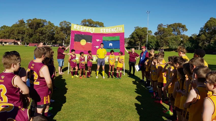 Quinns Districts Junior Football Club players with the indigenous round banner. Pictures: Shannon Dale