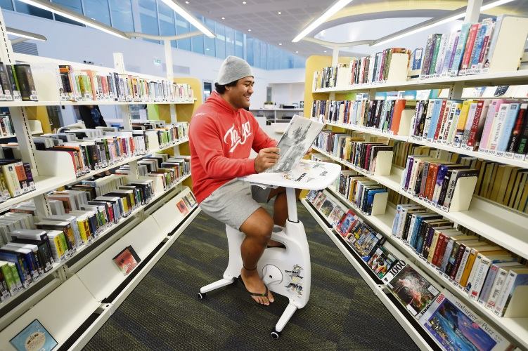 PICTURE: Bertram resident Trevita Luvelo takes the new bike desk at Kwinana Public Library for a spin. By Jon Hewson. D493501