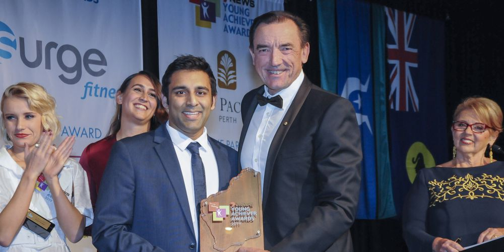 Jilen Patel receives the Western Australian Young Achiever of the Year award from Youth Minister Peter Tinley.