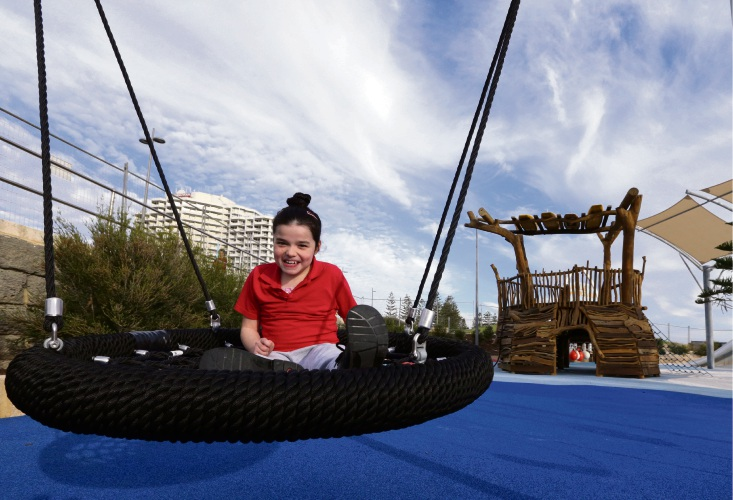Charlotte Fitspatrick (9), of Kingsley, tries out the accessible bird's nest swing at Scarborough's Whale Playground. Photo: Martin Kennealey d493591