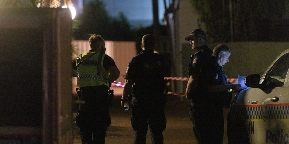 Police cordon off a block of units where a person was shot by a gunman in the suburb of The Gardens in Darwin last night. Photo: AAP