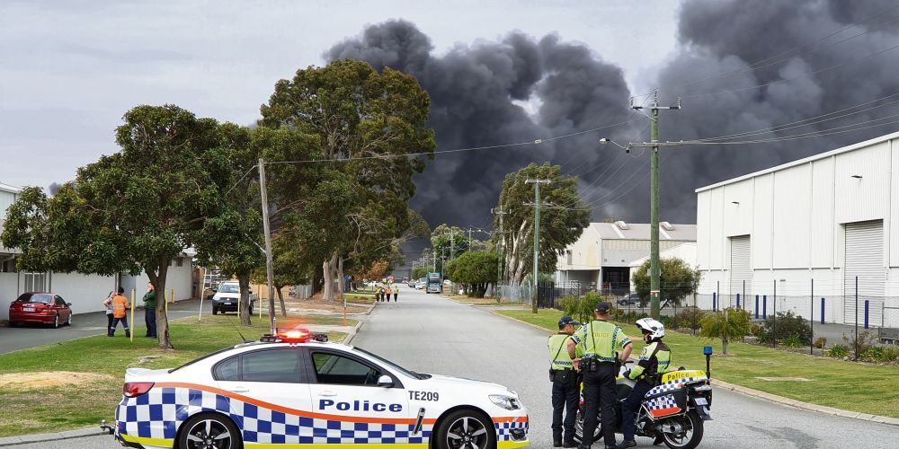 Police block off a road near the Kewdale fire. Picture: David Baylis