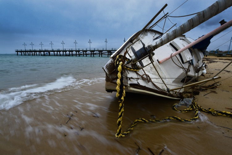 A yacht washed up on the Rockingham foreshore. Photo by Jon Hewson.