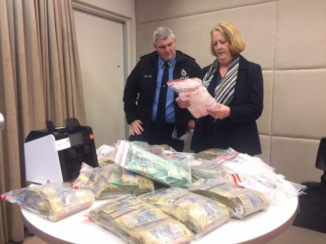 Deputy Commissioner Col Blanch and Police Minister Michelle Roberts with the seized cash and drugs.
