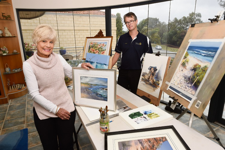 d493838 Attadale artist Pam Eddy and Rotary Club of Melville committee member James Morris. Picture: Jon Hewson