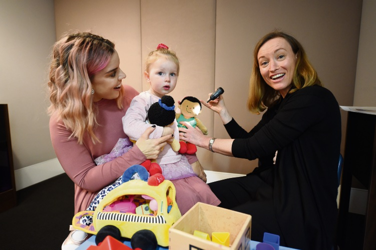 Philippa Hatch (TSH Head of Hearing Services) Breeahn Carter with daughter Matlida Carter (2). Photo: Jon Hewson. d493865 communitypix.com.au.