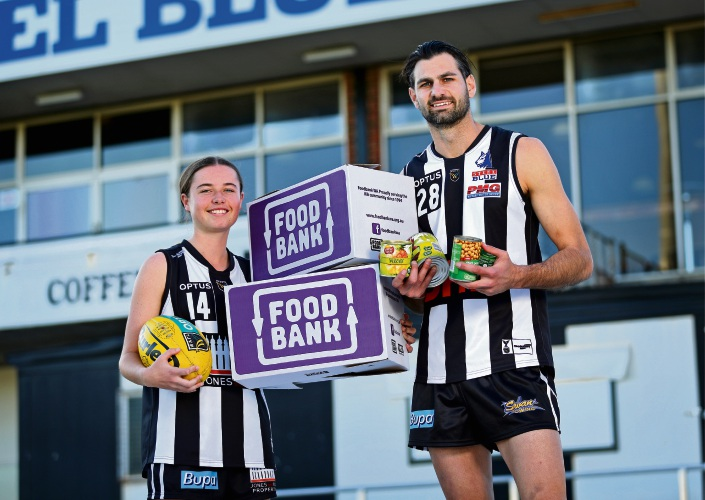 L-R: Swan Districts League Players Shanae Davison of Bennett Springs and Tony Notte of Herne Hill collecting for Foodbank.  Swan Districts will be collecting food tins from supporters at the WAFLW game on June 15 and WAFL game on June 16. Picture: David Baylis www.communitypix.com.au   d493693