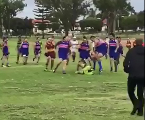 The Warwick Greenwood runner was taken to the ground and punched and kicked during a brawl at a a Metro Football League game on Sunday.