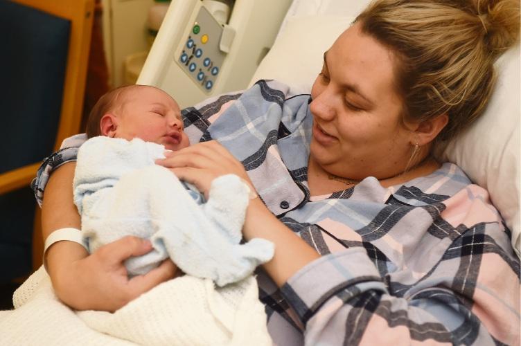 Jasmine O'Driscoll, of Halls Head, with baby Brax Johnson, born June 11. Picture: Jon Hewson www.communitypix.com.au d489952