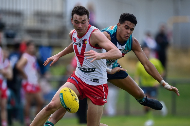 Peel Thunder's Jason Carter gives chase to South Fremantle's Zac De San Miguel in their clash on the weekend. Pictures: Jon Hewson