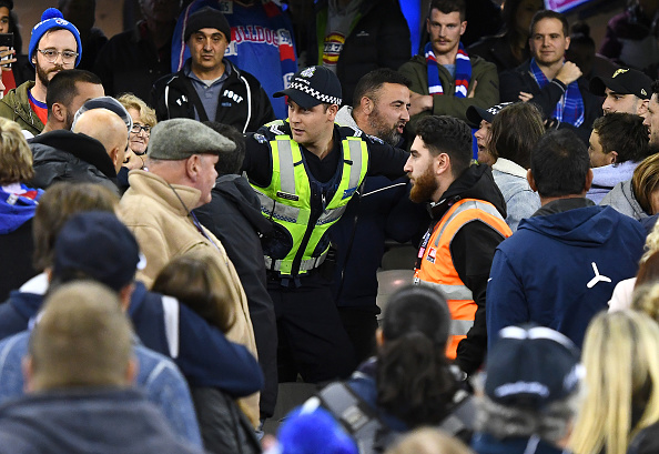 Police try to separate a fight in the crowd during the round 13 AFL match between the Carlton Blues and the Western Bulldogs at Marvel Stadium on June 15, 2019 in Melbourne, Australia. (Photo by Quinn Rooney/Getty Images)