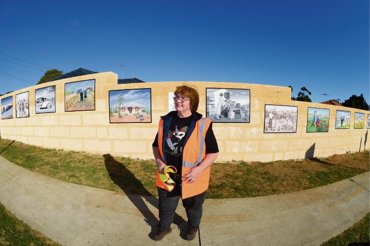 Artist Irene Osborne in front of the mural. Photo: Jon Hewson. 494082