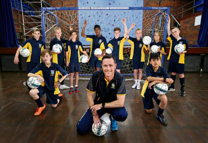 Lynwood SHS soccer academy head Tony Campbell with year 7 and 8 academy students. Picture: David Baylis. www.communitypix.com.au. d494132
