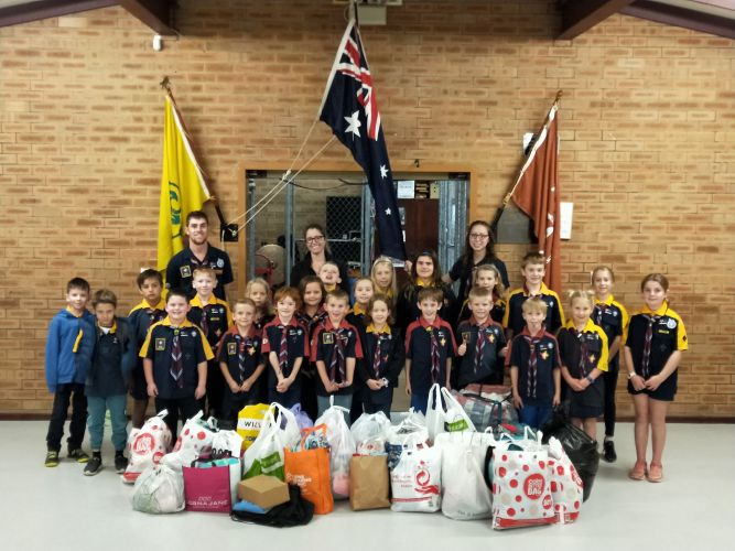 Beldon Scout Group joeys and cubs working on the Messenger of Peace badge collected clothing for St Vincent de Paul.