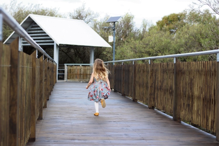 A young girl enjoys the Harvest Lakes boardwalk in Atwell: Samantha Joseph.