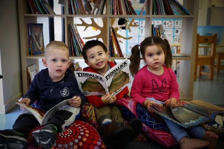 Connor Holleman (3), Lucca Jotta (3) and Layla Wright (3) Goodstart Early Learning has recently signed up to support The Great Book Swap which helps to buy Books for Indigenous Communities across Australia. Photo: Andrew Ritchie. d494235 communitypix.com.au