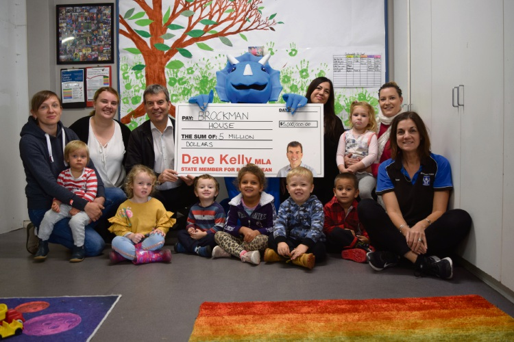 Svitlana Zatkhei, children's services manager Jessica de Mello, Bassendean MLA Dave Kelly, executive manager Rosina Mastrolembo, playgroup leaders Emilie O'Keefe and Susan Mercer with children from the playgroup.