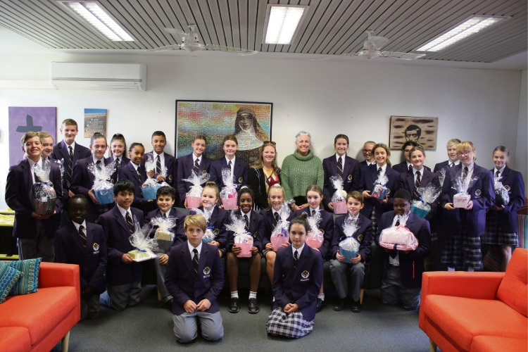 MercyCare school liaison officer Louise Mason and Irene McCormack Catholic College service learning coordinator Janice Bell with the Year 7 Evans House students.